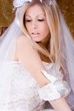 Bride. Sitting in wedding dress, studio shot stock photography