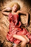 Bride. Lying down in red wedding dress, studio shot Royalty Free Stock Images