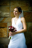 Bride. A young attractive bride against a stone wall Royalty Free Stock Photos