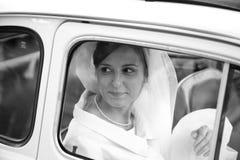 Bride. Happy Italian bride in a car Royalty Free Stock Photos