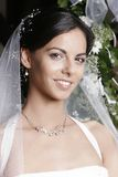 Bride. Smiling young attractive brunette bride before wedding stock photo