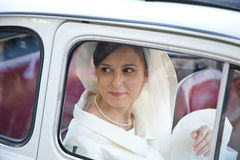 Bride. A smiling and happy bride in the car royalty free stock image