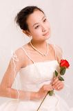 Bride. A Pretty Chinese bride with flower Royalty Free Stock Images