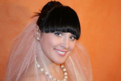 Bride. The bride on an orange background Stock Photo