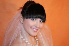 Bride. The bride on an orange background stock photo
