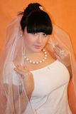 Bride. The bride on an orange background stock photography