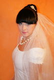 Bride. The bride on an orange background Royalty Free Stock Photo