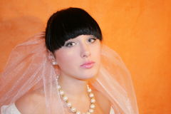 Bride. The bride on an orange background Royalty Free Stock Image