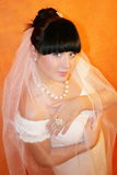 Bride. The bride on an orange background royalty free stock images