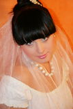 Bride. The bride on an orange background Stock Photos