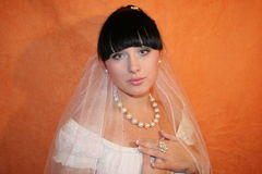 Bride. The bride on an orange background Royalty Free Stock Photography