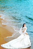 Bride. A young bride in wedding dress on a tropical beach Stock Image
