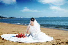 Bride. A young bride in wedding dress on a tropical beach Royalty Free Stock Photography