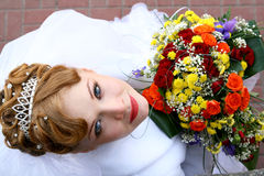 Bride. Looking up with a bouquet Royalty Free Stock Photos