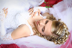 Bride. Young beautiful bride laying on the bed Stock Photos