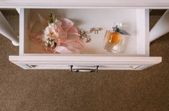 Bride accessories chest drawers perfume boutonniere jewelry stock photos