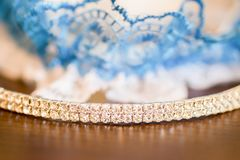 Bride accessories details. Head accessory with diamonds. garter in background Stock Photography