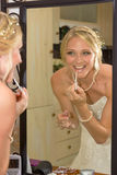 Bride add some lip gloss Stock Photo