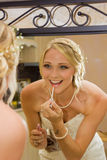 Bride add some lip gloss Royalty Free Stock Image