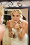 Bride add some lip gloss Royalty Free Stock Images