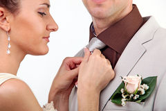 Bride adjusting groom's tie Stock Images