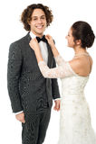 Bride adjusting her man's bow tie Stock Images
