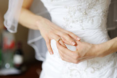 Bride adjusting her wedding ring Royalty Free Stock Images