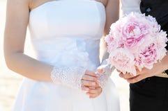 Bride adjusting her wedding ring Stock Photo