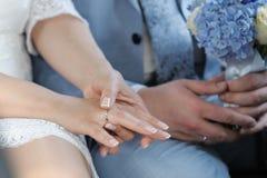 Bride adjusting her wedding ring Royalty Free Stock Photos