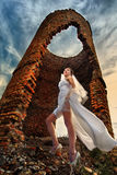 Bride against abandoned ruins Stock Photography