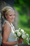 Bride against a stone wall Stock Image