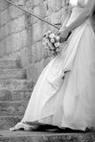 Bride against wall Stock Image