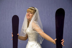 Bride with alpine skis Royalty Free Stock Photography