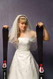 Bride with alpine skis Stock Photo
