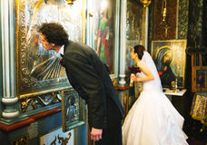 Bride And Groom Kissing Altar Wall Stock Photos