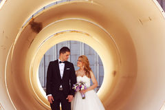 Free Bride And Groom Posing In A Big Pipe Royalty Free Stock Image - 50638846