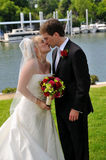Bride ang groom kissing after their wedding Royalty Free Stock Photography