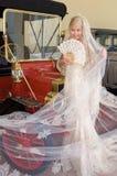 Bride and antique car Stock Photos