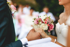 The bride apparel  a buttonhole for groom.  Royalty Free Stock Image