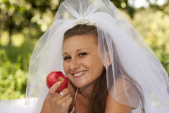 Bride with apple Stock Image