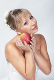 Bride with apple Royalty Free Stock Photos