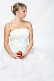 Bride with apple Stock Images