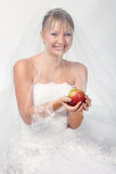 Bride with apple Stock Photos