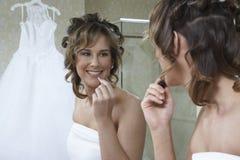 Bride Applying Lipstick Royalty Free Stock Photo