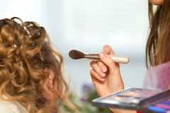 Bride applying wedding make-up Royalty Free Stock Photography