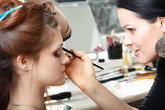 Bride applying wedding make-up Stock Image