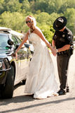 A bride is arrested on her wedding day Royalty Free Stock Image