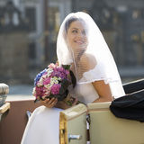 A bride arriving for her wedding Royalty Free Stock Photo