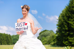 Bride as hitchhiker - wedding concept Stock Image