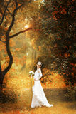 Bride on autumn forest Royalty Free Stock Photo